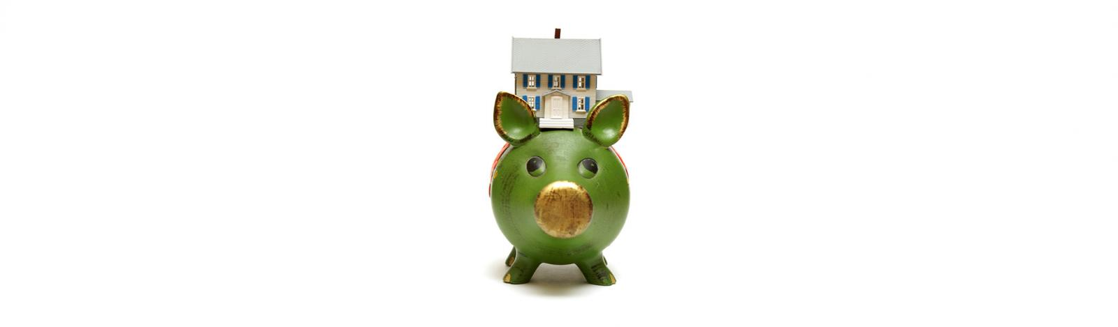 house sitting on top of a piggy bank